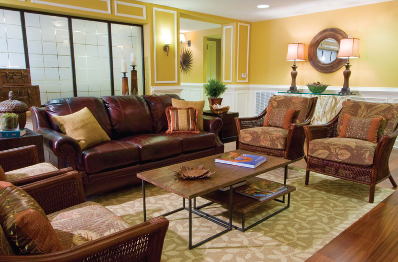 Classic living space with leather upholstered sofas and wicker chairs